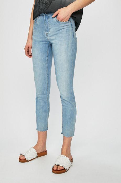 Jeansy damskie z ozdobnymi wystrzępieniami niebieskie