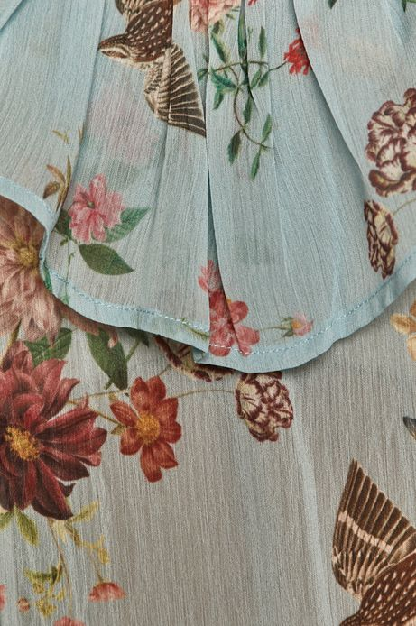 Bluzka damska w kwiaty z falbanką niebieska