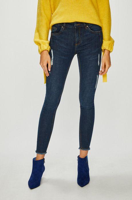 Jeansy damskie skinny granatowe z ozdobnymi wystrzępieniami