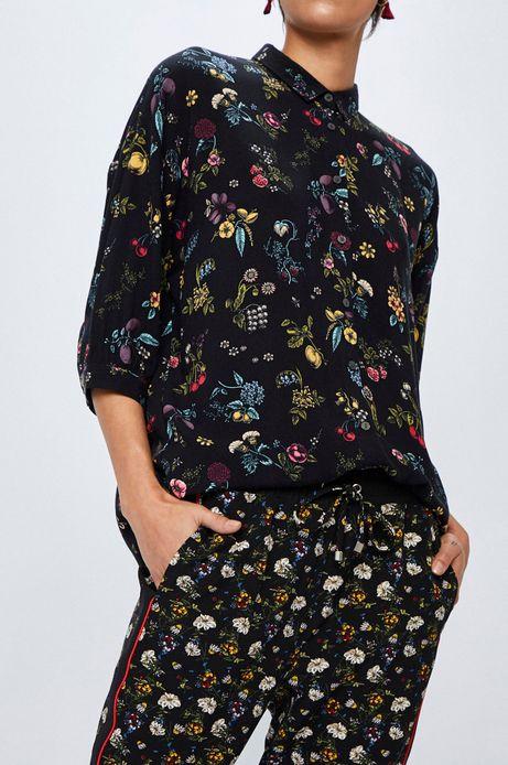 Spodnie damskie czarne we wzory z lampsami
