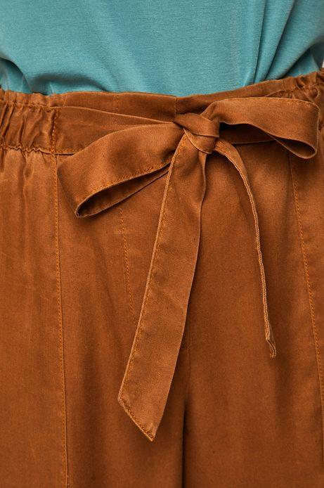 Spodnie damskie wiązane w talii beżowe