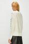 Sweter damski kremowy z ozdobnymi detalami